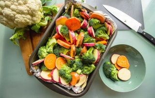 Tray of chopped and prepared fruits and vegetables