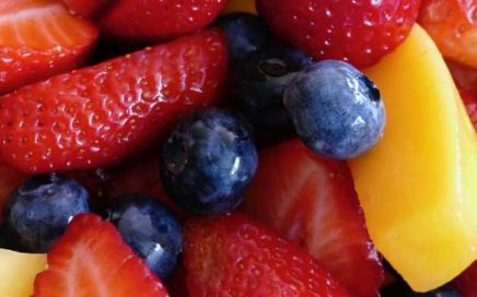 Fresh strawberries, blueberries, and mango slices mixed together for a nutritious diet