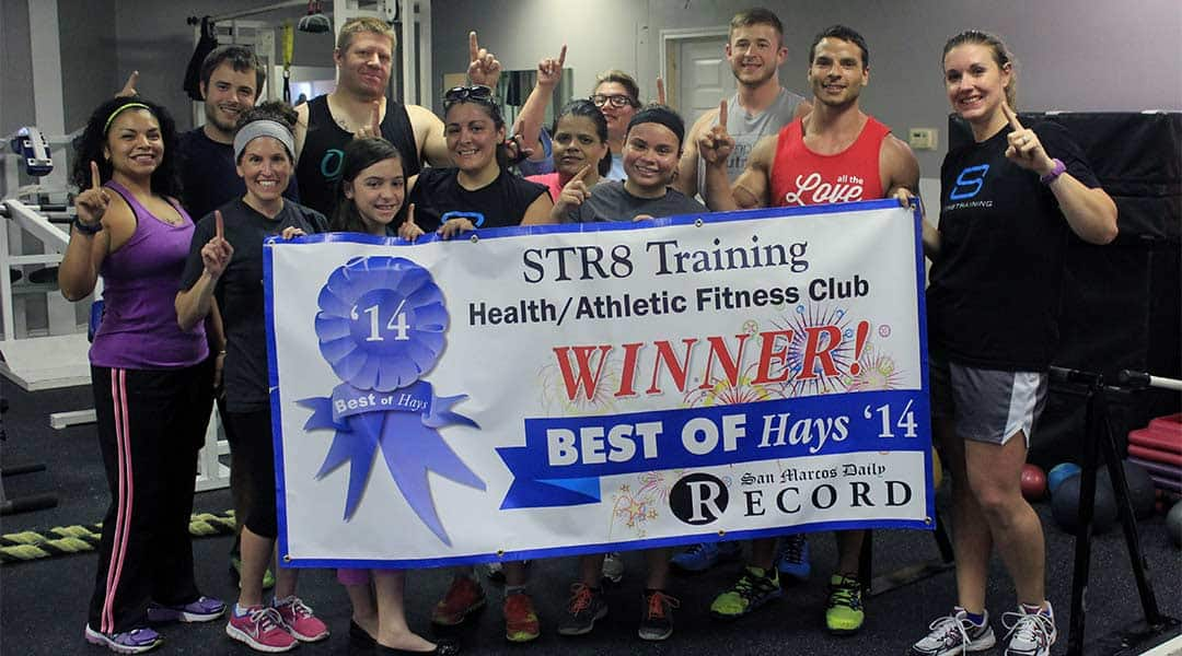 The Str8 Training team poses with their Best of Hays award banner.