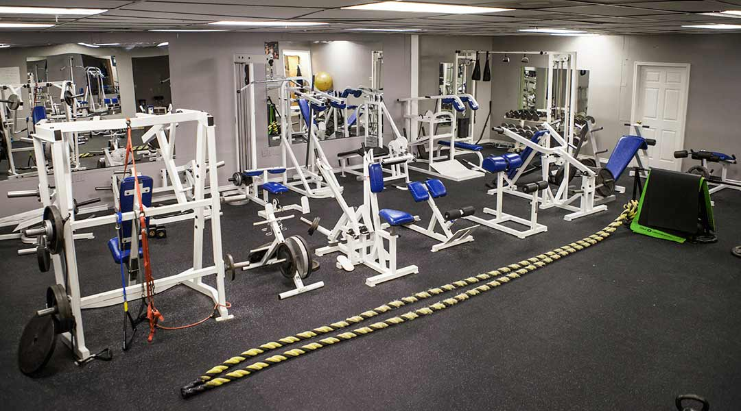 Equipment lines Str8 Training's private workout studio.