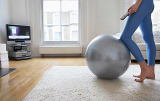 Woman using an exercise ball at home