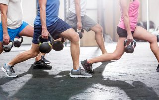 Men and women in crossfit training at a fitness gym in San Marcos